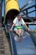 YOUNG GIRL ON TUBE SLIDE, ROSTHERN
