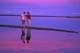 COUPLE WALKING ON SANDBAR, LAKE DIEFENBAKER, DANIELSON PROVINCIAL PARK