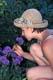 GIRL SMELLING FLOWERS, ST. DENIS
