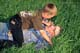 FATHER & SON WRESTLING IN GRASS, MEADOW LAKE