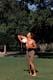 MAN PLAYING FRISBEE IN KIWANIS PARK, SASKATOON