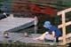 GIRL FEEDING DUCKS ON DOCK, HEART LAKES, PRINCE ALBERT NATIONAL PARK