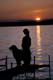 GIRL AND DOG ON DOCK AT SUNSET, MEADOW LAKE PROVINCIAL PARK