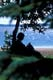 WOMAN READING BOOK UNDER TREE AT LAKESHORE, DANIELSON PROVINCIAL PARK