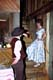 COWBOY TALKING TO SALOON GIRL ON STAIRS, ST. DENIS