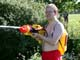 MALE PLAYING WITH WATER GUN, SASKATOON