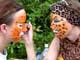 WOMAN PAINTING GIRL'S FACE, SASKATOON