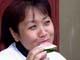 VIETNAMESE WOMAN EATING WATERMELON, SASKATOON