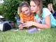 GIRLS CHOOSING CD'S, LISTENING TO MUSIC, SASKATOON