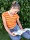 GIRL READING, SASKATOON