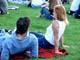 PEOPLE SITTING ON GRASS, SASKATOON