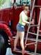 GIRL WASHING TRACTOR TRAILER, SASKATOON