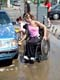 GIRL IN WHEELCHAIR WASHING CAR, SASKATOON