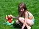 GIRL PLAYING WITH ELMO SPRINKLER, SASKATOON