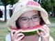 GIRL IN HAT EATING WATERMELON, SASKATOON