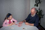 PEO ACT IND  SK     1402216DCHILD AND SENIOR PLAYING CARDSSASKATOON                       02                   © CLARENCE W. NORRIS      ALL RIGHTS RESERVEDACTIVITIES;BEARDS;CARDS;CHILDREN;FUN;GAMES;GRANDPARENTS;INDOORS;JENNIE;PEOPLE;PLAINS;PLAY;PRAIRIES;RECREATION;SASKATCHEWAN;SASKATOON;SENIORS;SK_;WINTERLONE PINE PHOTO              (306) 683-0889