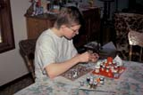 PEO ACT IND  SK     1402504D  MR15 YEAR OLD BOY PAINTING FIGURINESSASKATOON                       04                   © CLARENCE W. NORRIS      ALL RIGHTS RESERVEDACTIVITIES;CRAFTS;HOBBIES;INDOORS;MALE;MARC;MR_;PAINTING;PEOPLE;PLAINS;PRAIRIES;RECREATION;SASKATCHEWAN;SASKATOON;SK_;SPRING;TEENS;TOYSLONE PINE PHOTO              (306) 683-0889
