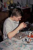 PEO ACT IND  SK     1402505D  VT  MR15 YEAR OLD BOY PAINTING FIGURINESSASKATOON                       04                   © CLARENCE W. NORRIS      ALL RIGHTS RESERVEDACTIVITIES;CRAFTS;HOBBIES;INDOORS;MALE;MARC;MR_;PAINTING;PEOPLE;PLAINS;PRAIRIES;RECREATION;SASKATCHEWAN;SASKATOON;SK_;SPRING;TEENS;TOYS;VTLLONE PINE PHOTO              (306) 683-0889