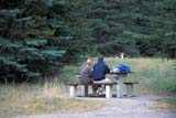 PEO ACT OUT  AB  LJN2103112DCOUPLE AT PICNIC TABLEUPPER BANKHEAD CAMPSITEBANFF NATIONAL PARK        08                   © LAURA NORRIS                 ALL RIGHTS RESERVEDAB_;ACTIVITIES;ALBERTA;ALPINE;BANFF_NP;BANKHEAD;CAMPING;CORDILLERA;COUPLE;DINING;FOOD;NP_;OUTDOORS;PEOPLE;PICNICS;SUMMER;UPPER_BANKHEADLONE PINE PHOTO              (306) 683-0889