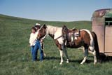 PEO ACT OUT  SK   WS21763D  NMR  MAN, WOMAN AND HORSEHILLS OF THE MISSOURI COTEAUCEYLON                              07/..© WAYNE SHIELS                ALL RIGHTS RESERVEDANIMALS;CEYLON;COUPLE;HORSES;LIVESTOCK;MISSOURI_COTEAU;OUTDOORS;PEOPLE;PLAINS;PRAIRIES;RANCHING;RURAL;SASKATCHEWAN;SK_;SUMMER;WESTERNLONE PINE PHOTO              (306) 683-0889