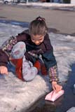 PEO ACT SPR  SK     1901230D  VT  MRGIRL PLAYING WITH PAPER BOAT IN SPRINGSASKATOON                       04                   © CLARENCE W. NORRIS      ALL RIGHTS RESERVEDACTIVITIES;BOATS;CHILDREN;GIRL;MELTWATER;MR_;OUTDOORS;PEOPLE;PLAINS;PRAIRIES;RECREATION;SASKATCHEWAN;SASKATOON;SK_;SNOW;SPRING;TOYS;VTLLONE PINE PHOTO              (306) 683-0889