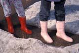PEO ACT SPR  SK     1901310D  MRCOLOURFUL RUBBER BOOTSSASKATOON                       04                   © CLARENCE W. NORRIS      ALL RIGHTS RESERVEDACTIVITIES;BOOTS;CHILDREN;CLOTHING;MELTWATER;MR_;OUTDOORS;PEOPLE;PLAINS;PRAIRIES;SASKATCHEWAN;SASKATOON;SK_;SNOW;SPRINGLONE PINE PHOTO              (306) 683-0889