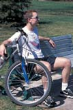 PEO ACT SPR  SK  CWN0203007D  VTMAN WITH BIKE SITTING ON PARK BENCHSASKATOON                       05                   © CLARENCE W. NORRIS      ALL RIGHTS RESERVEDACTIVITIES;BICYCLING;MALE;OUTDOORS;PARKS;PEOPLE;PLAINS;PRAIRIES;SASKATCHEWAN;SASKATOON;SK_;SPRING;TRANSPORTATION;TRAVEL;VTLLONE PINE PHOTO              (306) 683-0889