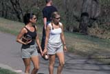 PEO ACT SPR  SK  CWN0203025DTWO WOMEN WITH BALL GLOVES WALKING IN PARKSASKATOON                       05                   © CLARENCE W. NORRIS      ALL RIGHTS RESERVEDACTIVITIES;FEMALE;MEEWASIN;OUTDOORS;PEOPLE;PLAINS;PRAIRIES;SASKATCHEWAN;SASKATOON;SK_;SPORTS;SPRING;TRAILS;URBAN;WALKINGLONE PINE PHOTO              (306) 683-0889