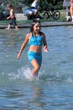 PEO ACT SUM  AB     2111213D  VTGIRL SPLASHING IN FOUNTAINDRUMHELLER                       08                   © CLARENCE W. NORRIS      ALL RIGHTS RESERVEDAB_;ACTIVITIES;ALBERTA;CHILDREN;DRUMHELLER;FUN;GIRL;OUTDOORS;PARKS;PEOPLE;PLAINS;PRAIRIES;RECREATION;SUMMER;VTL;WATER;WATER_PARKSLONE PINE PHOTO              (306) 683-0889