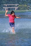 PEO ACT SUM  AB     2111210D  VTGIRL SPLASHING IN FOUNTAINDRUMHELLER                       08                   © CLARENCE W. NORRIS      ALL RIGHTS RESERVEDAB_;ACTIVITIES;ALBERTA;CHILDREN;DRUMHELLER;FUN;GIRL;OUTDOORS;PARKS;PEOPLE;PLAINS;PRAIRIES;RECREATION;SUMMER;VTL;WATER;WATER_PARKSLONE PINE PHOTO              (306) 683-0889