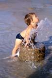 PEO ACT SUM  SK     0510121D  VTBOY PLAYING WITH WATER SPOUTKINSMEN PARKSASKATOON                       ..                   © CLARENCE W. NORRIS      ALL RIGHTS RESERVEDACTIVITIES;BOY;CHILDREN;FUN;KINSMEN_PARK;OUTDOORS;PARKS;PEOPLE;PLAINS;RECREATION;SASKATCHEWAN;SASKATOON;SK_;SUMMER;SWIMMING;VTL;WATER;WATER_PARKSLONE PINE PHOTO              (306) 683-0889