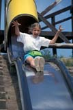 PEO ACT SUM  SK     1502504D  VT  MRYOUNG GIRL ON TUBE SLIDEROSTHERN                          07                   © CLARENCE W. NORRIS      ALL RIGHTS RESERVEDACTIVITIES;CHILDREN;FUN;GIRL;JENNIE;MR_;OUTDOORS;PEOPLE;PLAINS;PRAIRIES;RECREATION;ROSTHERN;SASKATCHEWAN;SK_;SLIDES;SUMMER;VTLLONE PINE PHOTO              (306) 683-0889