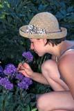 PEO ACT SUM  SK     1803718D  VTGIRL SMELLING FLOWERSST. DENIS                            07                   © CLARENCE W. NORRIS      ALL RIGHTS RESERVEDACTIVITIES;FEMALE;FLOWERS;GARDEN;HATS;OUTDOORS;PEOPLE;PLAINS;PRAIRIES;SASKATCHEWAN;SK_;ST_DENIS;SUMMER;TEENS;VTLLONE PINE PHOTO              (306) 683-0889