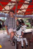 PEO ACT SUM  SK     2002425D  VT  MR # 343MAN ON CAROUSEL, KINSMEN PARKSASKATOON                       07                   © CLARENCE W. NORRIS      ALL RIGHTS RESERVEDACTIVITIES;CAROUSELS;FUN;KINSMEN;KINSMEN_PARK;MALE;MR_;OUTDOORS;PARKS;PEOPLE;PLAINS;PRAIRIES;RECREATION;RIDES;SASKATCHEWAN;SASKATOON;SK_;SUMMER;VTLLONE PINE PHOTO              (306) 683-0889