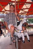 PEO ACT SUM  SK     2002426D  VT  MR # 343MAN ON CAROUSEL, KINSMEN PARKSASKATOON                       07                   © CLARENCE W. NORRIS      ALL RIGHTS RESERVEDACTIVITIES;CAROUSELS;FUN;KINSMEN;KINSMEN_PARK;MALE;MR_;OUTDOORS;PARKS;PEOPLE;PLAINS;PRAIRIES;RECREATION;RIDES;SASKATCHEWAN;SASKATOON;SK_;SUMMER;VTLLONE PINE PHOTO              (306) 683-0889