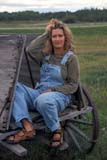 PEO ACT SUM  SK     2009117D  VT  MR # 348WOMAN ON OLD WAGONVANSCOY                           08                   © CLARENCE W. NORRIS      ALL RIGHTS RESERVEDACTIVITIES;FEMALE;FARMING;MR_;OUTDOORS;PEOPLE;PLAINS;PRAIRIES;RURAL;SASKATCHEWAN;SK_;SUMMER;VANSCOY;VTL;WAGONS;WESTERNLONE PINE PHOTO              (306) 683-0889