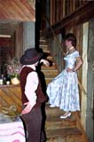 PEO ACT SUM  SK  CWN02A053D  MR  VTCOWBOY TALKING TO SALOON GIRL ON STAIRS  HOWLING COYOTE SALOONST. DENIS                               01..           © CLARENCE W. NORRIS         ALL RIGHTS RESERVEDACTIVITIES;CLOTHING;COUPLE;COSTUMES;HOWLING_COYOTE_SALOON;INDOORS;MR_;PEOPLE;PLAINS;PRAIRIES;ROMANCE;RURAL;SASKATCHEWAN;SK_;ST_DENIS;VTL;WESTERNLONE PINE PHOTO                  (306) 683-0889
