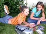PEO ACT SUM  SK  CWN02D2831D  MR# 356 &361    GIRLS CHOOSING CD'S, LISTENING TO MUSICSASKATOON                           08/. .© CLARENCE W. NORRIS          ALL RIGHTS RESERVEDACTIVITIES;FEMALE;FRIENDS;MR_;MUSIC;OUTDOORS;PEOPLE;PLAINS;PRAIRIES;RECREATION;SASKATCHEWAN;SASKATOON;SK_;SUMMER;TEENSLONE PINE PHOTO                  (306) 683-0889