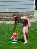 PEO ACT SUM  SK   CWN02T0190D  MR # 356  VT     GIRL PLAYING WITH ELMO SPRINKLERSASKATOON                            06..© CLARENCE W. NORRIS           ALL RIGHTS RESERVEDACTIVITIES;CHILDREN;ELMO;FUN;GIRL;MR_;OUTDOORS;PEOPLE;PLAINS;PRAIRIES;SASKATCHEWAN;SK_;SPRINKLERS;SUMMER;SWIMSUITS;VTL;WATER  LONE PINE PHOTO                  (306) 683-0889