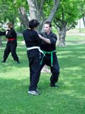 PEO ACT SUM  SK   CWN02T0191D  NMR  VT    MARTIAL ARTS PRACTICE IN PARK.SASKATOON                            06..© CLARENCE W. NORRIS           ALL RIGHTS RESERVEDACTIVITIES;MARTIAL_ARTS;OUTDOORS;PARKS;PEOPLE;PLAINS;PRAIRIES;RECREATION;SASKATCHEWAN;SASKATOON;SK_;SPORTS;SUMMER;UNIFORMS;VTLLONE PINE PHOTO                  (306) 683-0889