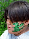 PEO ACT SUM  SK   CWN02T0103D  NMR  VTBOY WITH DRAGON PAINTED ON FACESASKATOON                            06..© CLARENCE W. NORRIS           ALL RIGHTS RESERVEDABORIGINAL;ART;BOY;CHILDREN;CULTURE;DRAGONS;FACE_PAINTING;MALE;OUTDOORS;PLAINS;PRAIRIES;SASKATCHEWAN;SASKATOON;SK_;SUMMER;VTL  LONE PINE PHOTO                  (306) 683-0889