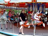 PEO ACT SUM  SK   CWN02T0211D  NMR  PEOPLE ON MERRY-GO-ROUNDSASKATOON                            06..© CLARENCE W. NORRIS           ALL RIGHTS RESERVEDACTIVITIES;CAROUSELS;CHILDREN;FAMILIES;FUN;KINSMEN_PARK;MERRY_GO_ROUNDS;OUTDOORS;PARKS;PEOPLE;PLAINS;PRAIRIES;RECREATION;RIDES;SASKATCHEWAN;SASKATOON;SK_;SUMMERLONE PINE PHOTO                  (306) 683-0889