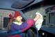 YOUNG GIRL CLEANING INTERIOR OF CAR, SASKATOON