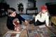 BOY & GIRL PLAYING BOARD GAME ON FLOOR, SASKATOON