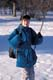 GIRL & BACKPACK ON SWING IN WINTER, SASKATOON