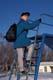 GIRL & BACKPACK ON TOP OF SLIDE IN WINTER, SASKATOON