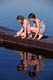 GIRLS ON DOCK LOOKING AT OBJECTS IN THE WATER, PIKE LAKE PROVINCIAL PARK