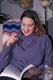 GIRL WITH GLASSES READING BOOK, SASKATOON