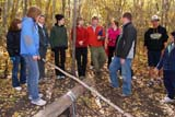 PEO ACT OUT  SK  WDS08I7013DXTEAM BUILDING ACTIVITIES FOR TEACHERS AND SUPPORT STAFFCAMP SHEKINAH                 09© WAYNE SHIELS               ALL RIGHTS RESERVEDACTIVITIES;ADULTS;AUTUMN;CAMP_SHEKINAH;CO_ED;FOREST;GROUPS;LOGS;OUTDOORS;PEOPLE;PLAINS;PRAIRIES;SASKATCHEWAN;SK_;TEAMWORK;TREESLONE PINE PHOTO              (306) 683-0889