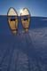SNOWSHOES IN SNOWDRIFT BACKLIT BY WINTER SUN, WAKAW